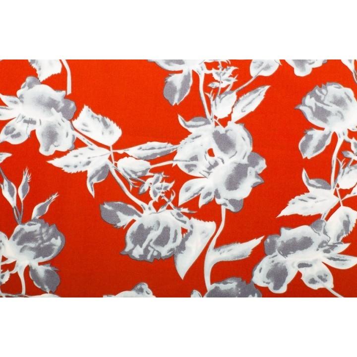 Tissu motif fleur sur fond rouge