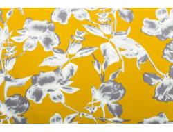 Tissu motif fleur sur fond moutarde