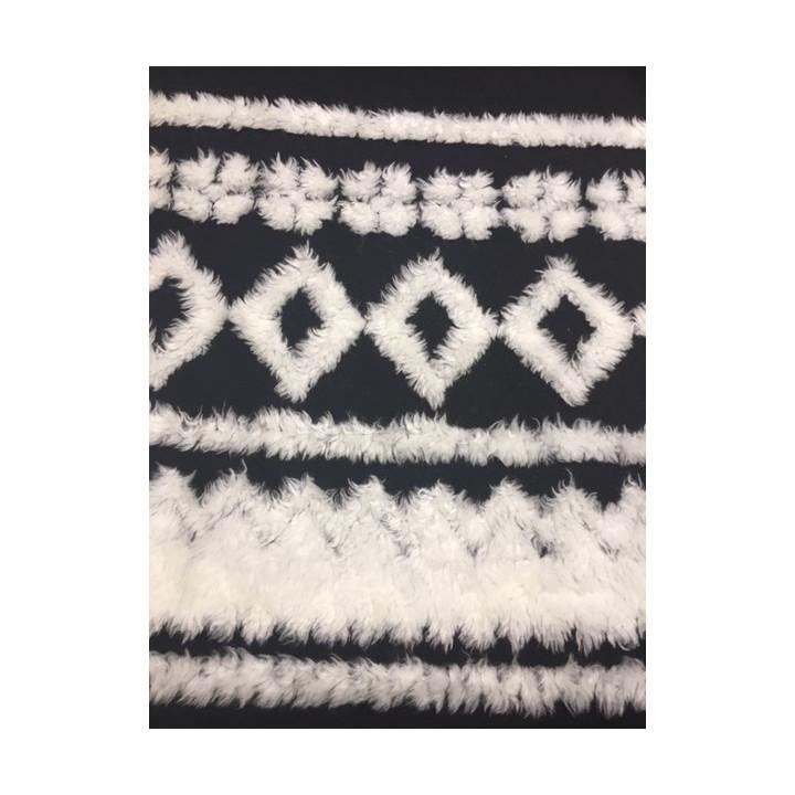 Tissu laine noir décors fourrure blanche