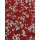 Tissu rouge motif petites fleurs blanches